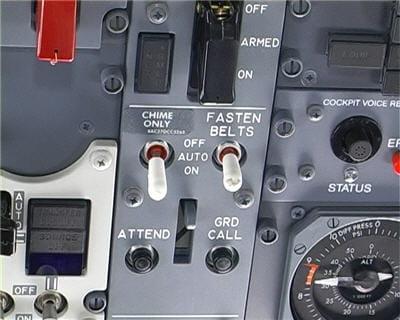 bouton d'allumage du voyant 'attachez vos ceintures' situé en cabine